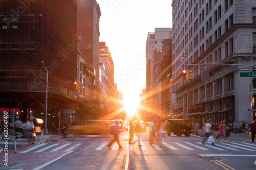 New York City street scene with crowds of people and traffic in Manhattan