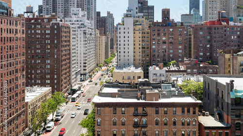 Panoramic overhead view of busy street scene in Midtown Manhattan New York City