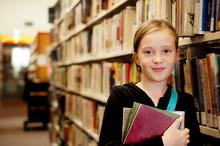 Portrait Of Girl Holding Books...