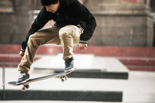 Full length of man performing skateboard stunt at skateboard park