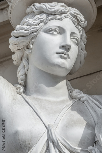 Photo Stands Historic monument Portrait of balcony support statue of young and naked sensual Roman renaissance era women in Vienna, Austria, details, closeup