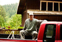 Portrait On Man Sitting In Pick-up Truck