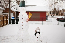 Snowmen On Snow Field During Winter