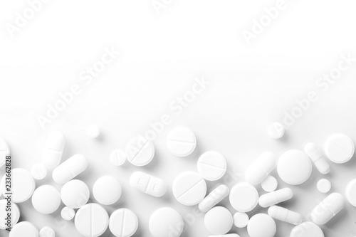 Pharmacy theme, white medicine tablets antibiotic pills. Canvas Print