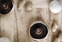 Overhead View Of Mushrooms And Peanuts On Cutting Board