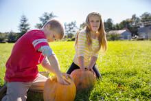 Siblings Removing Pumpkin Pulp...