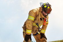 Exhausted Firefighter Against Clear Sky