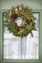 Wreath Hanging On Glass Window