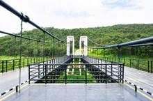 Closeup Metal Suspension Bridge At Mae Kuang Udom Thara Dam Background In Chiang Mai,Thailand