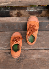 Old Sneakers On Wood Background