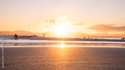 Leinwand Poster Golden Beach Sunset Byron Bay Australia