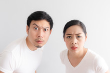 Funny Face Of Lovers Couple In Doubt At An Unbelievable Thing That They Are Looking At