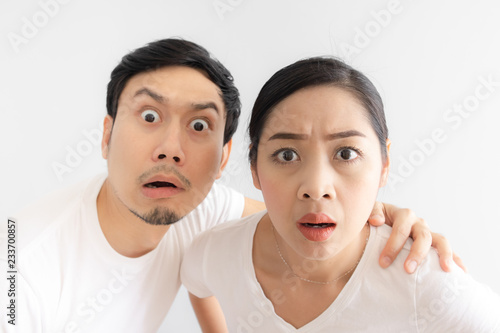 Funny face of lovers couple in doubt at an unbelievable thing that they are look Wallpaper Mural