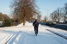 Commuter Cycling On A Snow Cov...