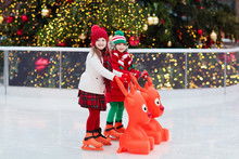 Kids Ice Skating In Winter. Ic...