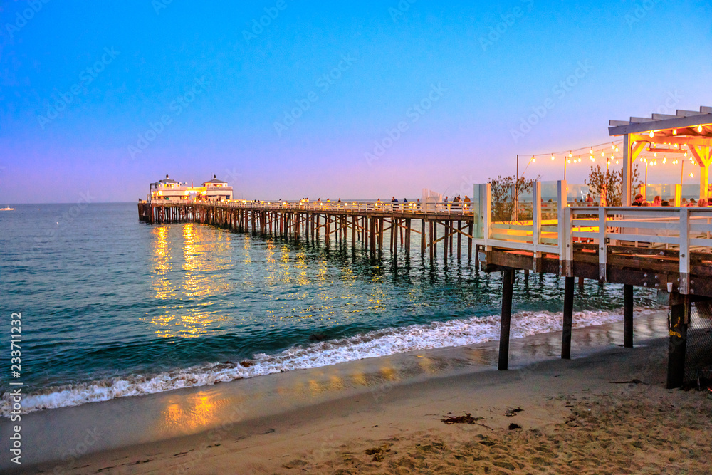 Fototapety, obrazy: Scenic coastal landscape illuminated by night of Malibu Pier in Malibu, California, United States see from Carbon Beach. Malibu Pier is an historic landmark. Blue hour shot. Copy space.