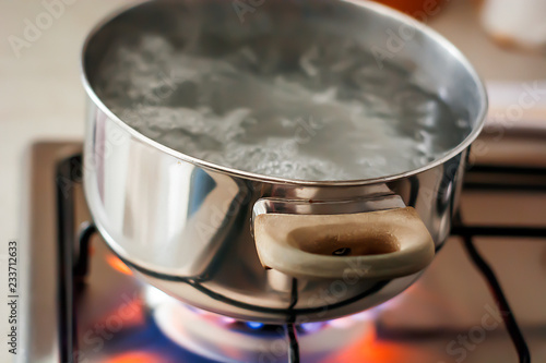 Valokuva  Water boiling in a pot over a lit stove