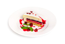 Plate With Sweet Layered Cheesecake Dessert Decorated With Mint And Strawberry Jam Cream Isolated At White Background.