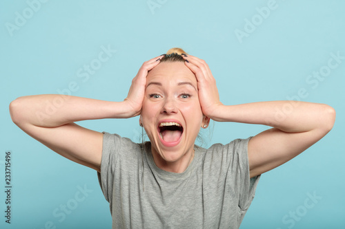overexcited and enthusiastic woman screaming with happiness Poster Mural XXL