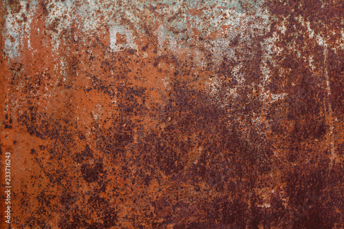 Poster Metal Rusty yellow-red textured metal surface. The texture of the metal sheet is prone to oxidation and corrosion. Textured background in grunge Style