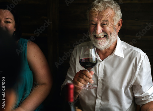 Cheerful man holding a wine glass