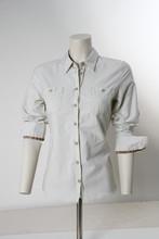 White Blouse Shirt On Tailor´s Dressmaker´s Dummy In Front Of White Background