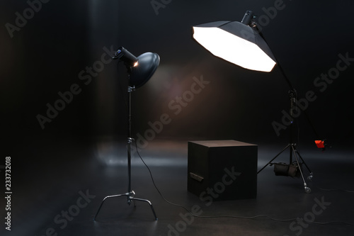 Professional lighting equipment on dark background Wallpaper Mural