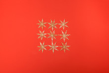 Gold Stars Christmas Decoration On A Red Background