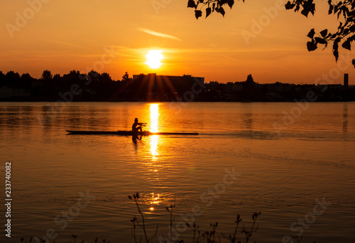Silhouette capture of person kayaking at sunset Canvas Print