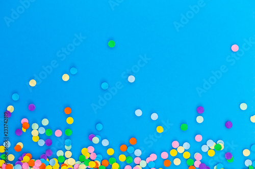 Colorful confetti on blue background.