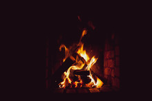 A Bright Fire Burns In An Old Fireplace.