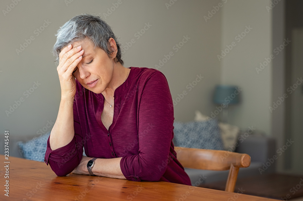Fototapeta Stressed senior woman at home