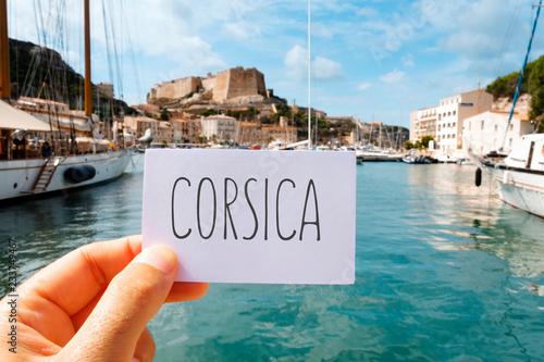 Foto op Aluminium Europese Plekken word Corsica in a signboard in Bonifacio, Corsica