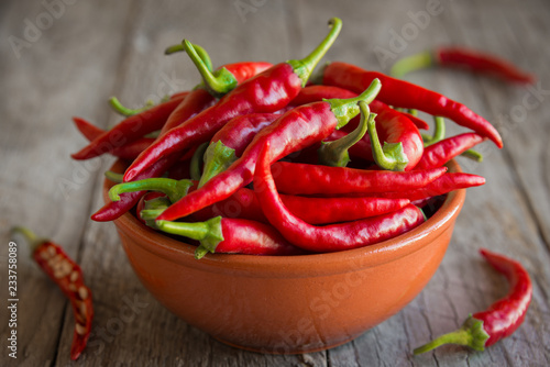 Deurstickers Hot chili peppers Hot chili peppers on wooden background
