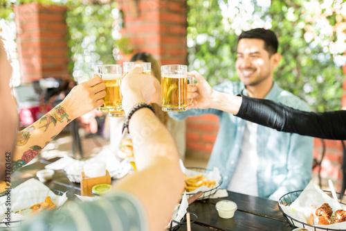 Fotografie, Obraz  Men And Women Cheering Beer At Eatery