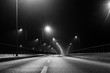 Bridge at night, black and white, foggy road, lanterns and fog