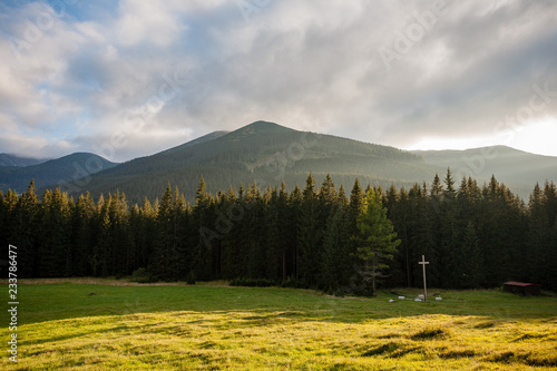 cloudy and misty Slovakian Western Carpathian Tatra Mountain skyline covered with forests and trees