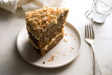 Slice Of Roasted Banana And Coconut Cake Served In Plate