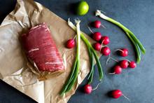Close Up Of Flank Steak With Scallions, Radish And Lemon