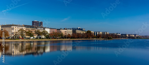 Colorful houses and building reflecting on the artificial lakes in Copenhagen in Canvas Print