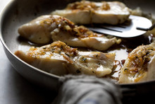 Close Up Of Cod Frying In Frying Pan