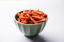 Carrot Pickle / Gajar Ka Achar Or Loncha In Hindi. Served In A Bowl Over Moody Background. Selective Focus
