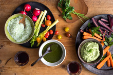Overhead View Of Vegetables Served With Dips
