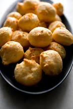 Close Up Of Pancetta And Sage Gougeres On Dish