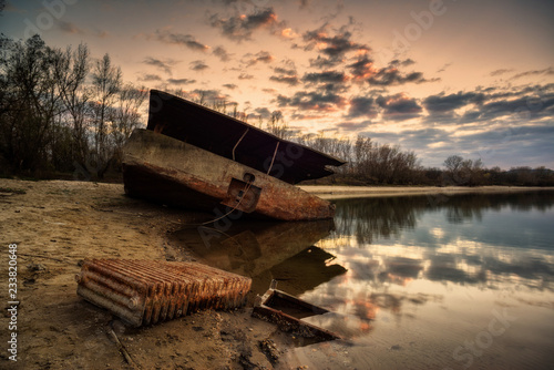Foto op Canvas Schipbreuk Rusty abandoned ship wreck in ship graveyard with dramatic effect
