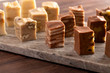 Six Different Flavors of Fudge on a Wooden Table