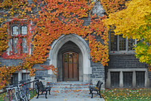 Entrance To Old Ivy Covered Gothic Stone College Building With Fall Colors