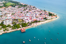 Stone Town, Old Colonial Center Of Zanzibar City. House Of Wonders. Old Fort. Azure Sea And Stunning Yellow Beaches. Unguja Island, Tanzania. Aerial.