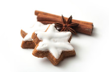Closeup Of Christmas Biscuit Shaped Star With Anise Flower And Cinnamon Stick On White Background