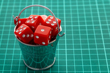 Dice Red In A Metal Bucket. Co...